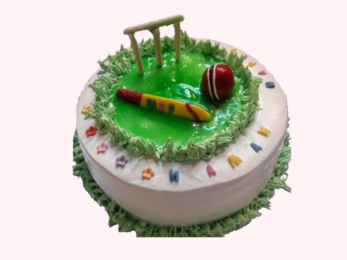 Cricket themed cream cake with fondant toppers